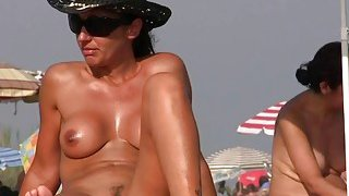 Nudist on the beach with big boobs is taking a shower Preview Image