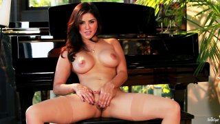 Sunny Leone fingering her pussy by the piano Preview Image