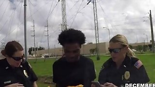 Cock hungry female cops take a huge dick of a black felon and blows it Preview Image