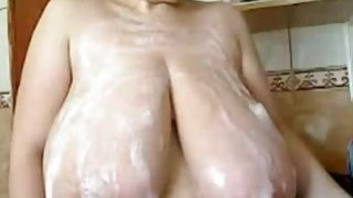Milf puts foam on her huge tits on webcam Preview Image
