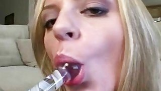 Dirty talking blonde masturbates with a glass dildo Preview Image