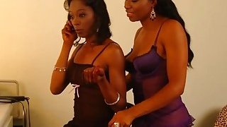 A black babe takes care of friend's pussy with her tongue and a dildo Preview Image