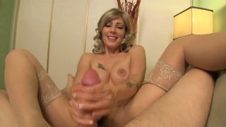 Busty MILF in stockings gives an amazing handjob in POV Preview Image