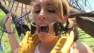 Kinky and freaky Bella gets tied up in the woods and fingered hard Preview Image
