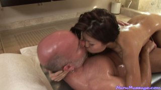 Horny masseuse Jackie Lin rides her customer in the bath_tub Preview Image