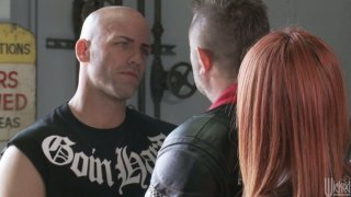 Horny red haired biker Kirsten Price enjoys a hot cunnilingus Preview Image