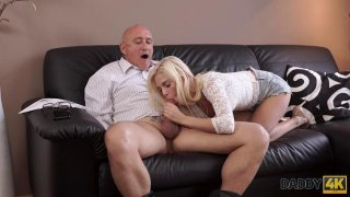 Slutty blonde sucks and fucks an old fart while smiling Preview Image