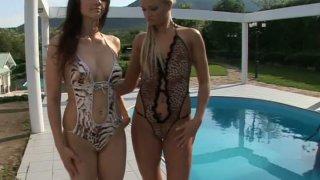 Aletta Ocean and Ksara in mini bikini by pool side Preview Image