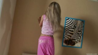 Flexible blonde teen Katie wankers on a bed using her favorite toy Preview Image