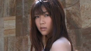 Frisky brunette Asian Mami Nagaoka takes a tap in the swimming_pool Preview Image