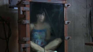 Brunette_Elise_Graves_is_locked_into_a_small_glass_box Preview Image