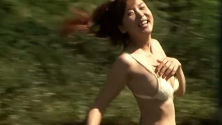 Tempting_Japanese_cutie_China_Fukunaga_flashes_her_panties_and_bikini Preview Image