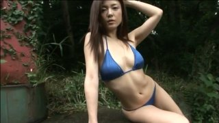 Wearing various bikinis hot and sexy Asian babe_poses_on camera Preview Image