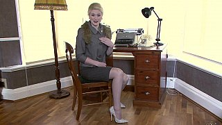 Stylish blonde teasing you in her office Preview Image