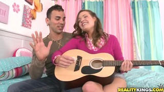 Ashlynn_Leigh_and_Voodoo_come_electrified_playing_a_gitar Preview Image