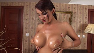 Redhead with big oiled natural tits in oral action Preview Image
