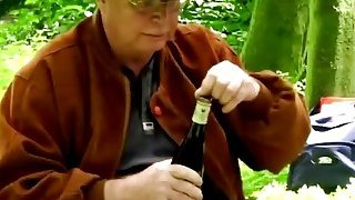 A naughty brunette teen sucks a dick of a horny older man in a forest Preview Image