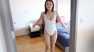 Smiley Blonde Thai Girl Enjoys Her Work Preview Image