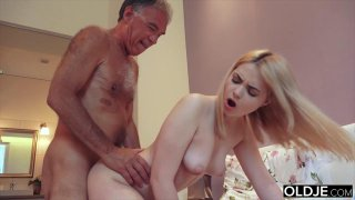 Nympho sucks grandpa cock has sex with him on her Preview Image