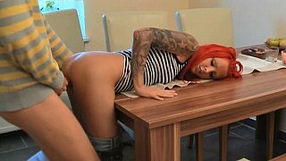 German redhead girlfriend gets it on_a kitchen table Preview Image