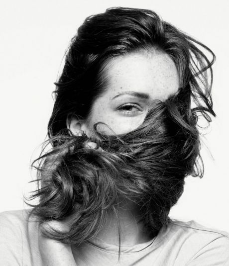 Girl hiding in her hair