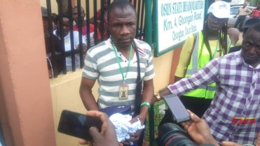 Image result for Osun: INEC officer arrested for allegedly tearing controversial result sheet