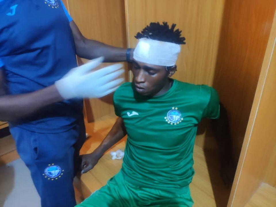 Injured Enyimba keeper Sabirou Bassa-Djeri being treated