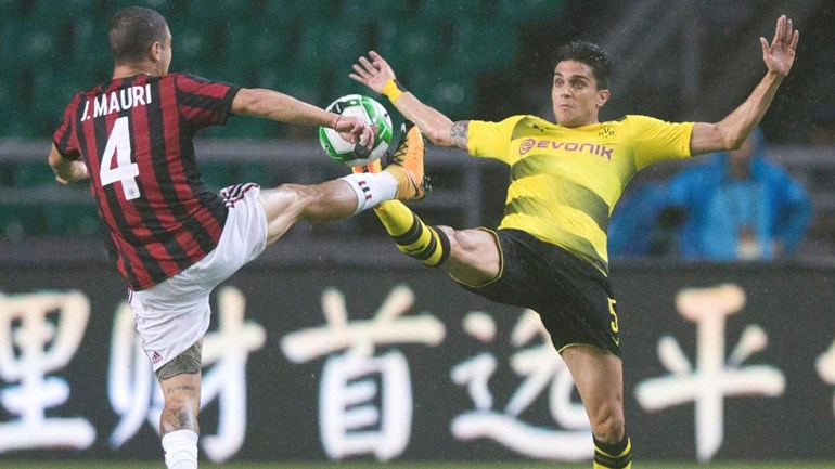 Borussia Dortmund 'arruma' Milan sem poder de fogo