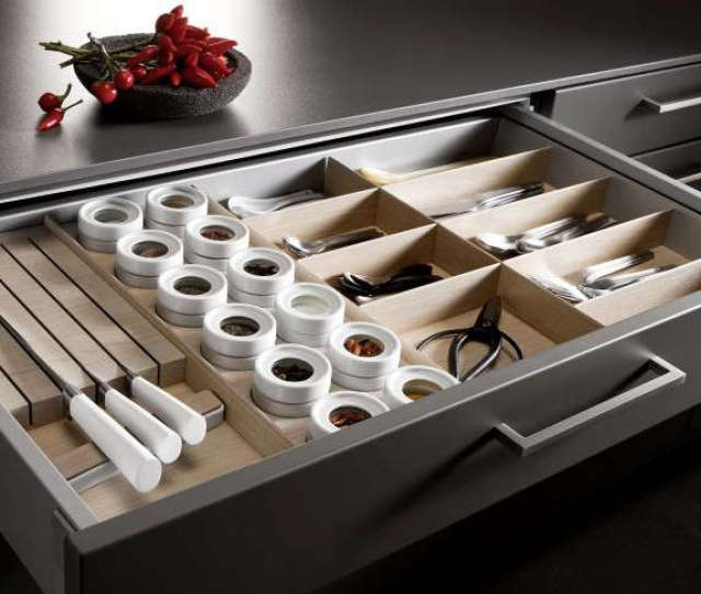 A Tailormade Storage Drawer With Sections For Knives Flatware Spices And Other Tools From