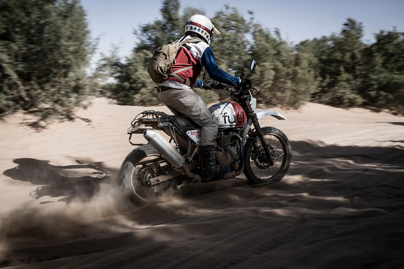 Custom Scrambler Riding across sand
