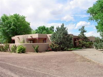 Exquisite pueblo-style home on 13.77 acres! Features include 2809 sf, 3 bedrooms, 3-1/2 baths, master bath Jacuzzi tub, study, great room with wood burning stove, bird atrium in foyer, chef's kitchen w/island & breakfast bar, breakfast nook and dining area. New wood flooring in dining room & living room. 3 covered patios, walled backyard, trees and rose bushes, double car garage plus detached 2 car garage. Equestrian barn/stables, 620 sf apartment, office/tack room, training horse walker, 27 horse stalls, pipe fenced pasture and irrigation. Fabulous location convenient to shopping, theatre, churches, schools, & easy access to I-25. Bring your family & your animals--this is a great place to call Home!
