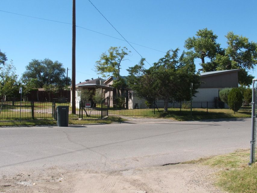 Old/Charming/Historic, thick adobe walls, exposed Beam-vegas, possibly built in the late 1800's Lots of possibilities. Large corner lot.