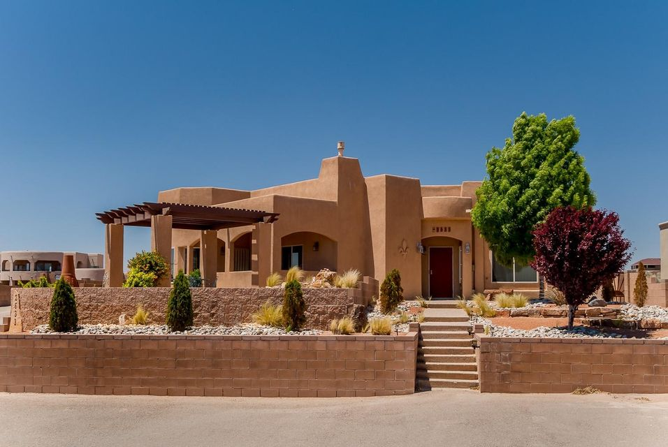 OWNER/BUILDER, Atop a hill, offering incredible, unobstructed Sandia mnt views w/ pure custom luxury, beginning with 10' ceilings and unique floor plan. Wall to wall beautiful natural slate tile, exposed ceiling beams and an artisan Southwestern heat and glo fireplace, many corbel and wood beam accents; curved walls; lit shelving. Bay window style breakfast nook w/ fixed window mnt views and a large beautiful formal DR w/ vaulted ceilings. Beautiful natural pine tongue and groove wood ceilings. Kitchen features vast custom cabinetry and luxurious granite tile counters, a large pantry, in addition to top of the line Whirlpool appliances. Custom lit nichos abundant throughout the home w/ ceiling fans in nearly every room. Both master and 2nd bedrooms feature massive custom