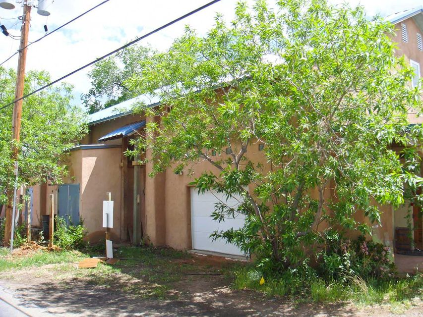 Live and Work Opportunity Foreclosure.  Original price was $395,000. Discounted to sell! Would need to be converted to residential. Currently a large 4,000 sqft warehouse, workshop, 1200 feet of office upstairs. Metal Roof, 150' Water Well, Two 1,200 Gallon Septic Tanks, 400 Amp Power, Evaporative Cooling. Warehouse Features Include: 3 Drive-In Doors, Clear Span, 12' Ceilings. Office Features Include: Wood Flooring Baseboards Heating.
