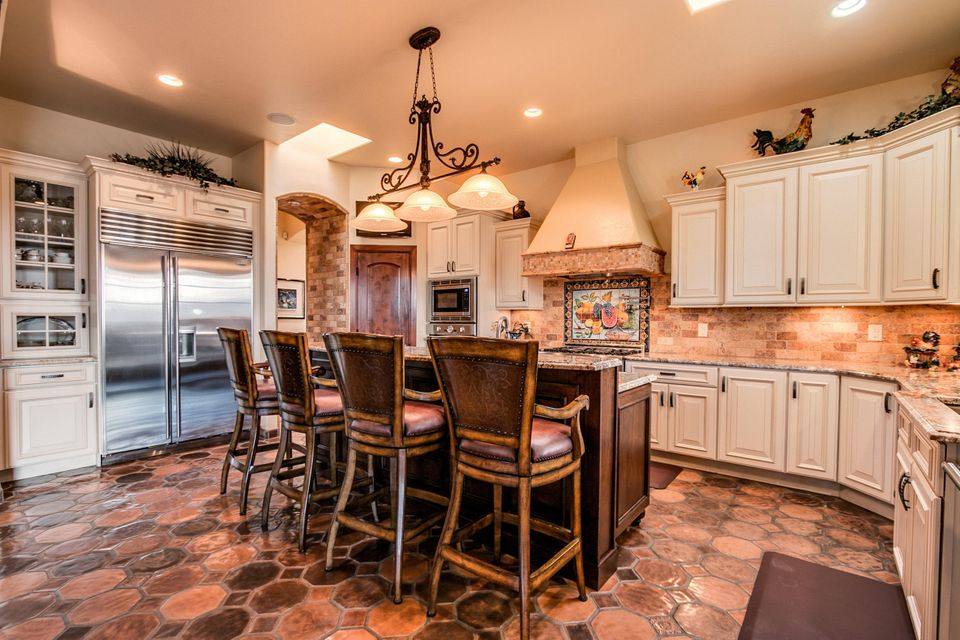 Breathtaking views of this corner acre give a full luxurious view of the Sandia Mountains! A masterfully-designed dream home detailed in every aspect. Numerous skylights illuminate this open floor plan and the beauty of the natural hickory & oak wood flooring. Artfully designed cabinetry complements granite countertops within gourmet chef's kitchen w/Subzero & Thermador appliances. Versatile home with studio/hobby room, home theater, exercise room, and office w/custom built-ins & private entry. Central vacuum, water softener, dual reverse osmosis, active solar panels & more. Perfect outdoor kitchen/entertaining space including a built-in grill. With automated gates leading to a fully landscaped acre w/2 cascading water features, it's NO WONDER this is a Parade of Homes Silver Award Winner!