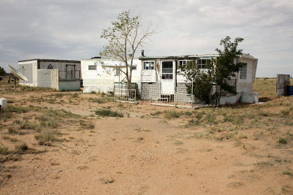 1.25 acre on shared well.  Has two out buildings and metal storage shed.  Handyman special.  Property is completely fenced.