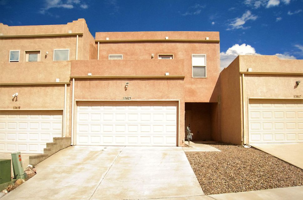 This beautiful Town Home is located near the Sandia and Manzano Mountains. Easy access to I-40 and shopping. Has 2Br, 2.5Ba, 2 story, living room, 1/2 bath downstairs , open kitchen w/electric stove, refrigerator, dishwasher, garbage disposal, ceiling fans, closet laundry, washer & dryer hookups, gas furnace, refrigerated air, 2 car garage w/ opener, xeriscaped yards