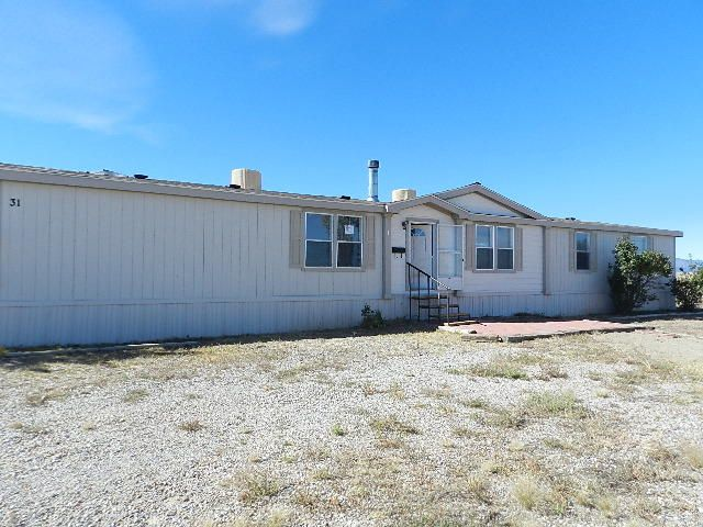 This Fannie Mae HomePath property offers a spacious and open floor plan with 4 bedrooms and 2 bathrooms. The master suite has a jetted tub, double sinks and a separate shower. Located on a large 5 acre lot and close to I-40, making for an easy commute to Albuquerque or Edgewood/Moriarty. **This property to be marketed for an online auction. Per auction company 3/17/17-a bid has been accepted at this time during the previous auction period. Awaiting bid confirmation/documents.**