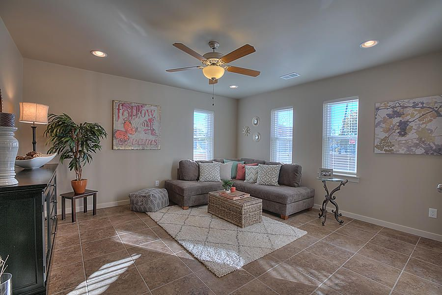 Located in the heart of the Albuquerque Country Club area, this town home boasts all of the best of modern living. Minutes from Downtown, Old Town, the Zoo, Bosque Trail access, the area's brand new grocery store, and the new ABQ Rapid Transit stop. The spacious floorpan provides many options: live/work and rental, with private entrances on both the upper and ground floors.  The light and bright open floor plan features hardwood floors throughout, contemporary kitchen with granite counter tops and stainless steel appliances.  The main living area and kitchen are located on the upper level, with full bath and abundant living space on the lower level.  All of this, plus a 2-car garage. Don't miss this excellent opportunity to call Downtown Albuquerque your home!