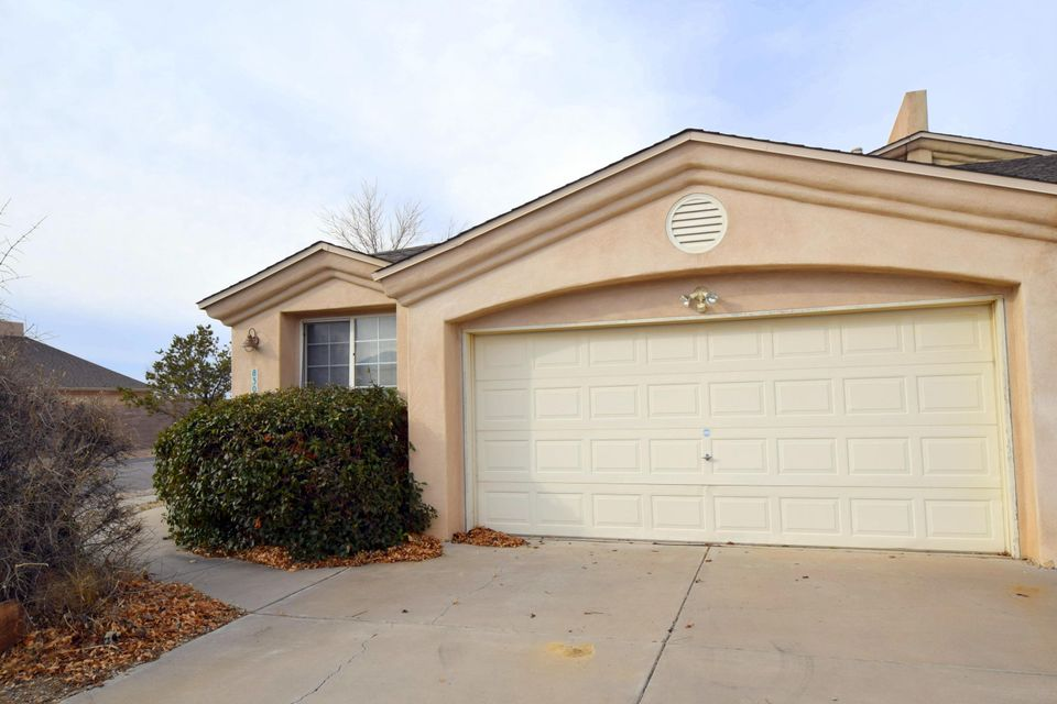 Light, bright, and ready for you! This conveniently located charmer is in the NE Heights close to shopping, restaurants, I-25, and in the La Cueva School District. Features Skylights, Wood Laminate Floors, 18'' Ceramic Tile, Alarm System, Ceiling Fans, Newer Water Heater (2015), Vaulted Ceilings in Great Room, Gas Fire Place, Master Walk-in Closet with a California Closet System, Courtyard with a Security Gate and so much MORE! No HOA! Now's YOUR opportunity to own in the coveted heights for a great price!