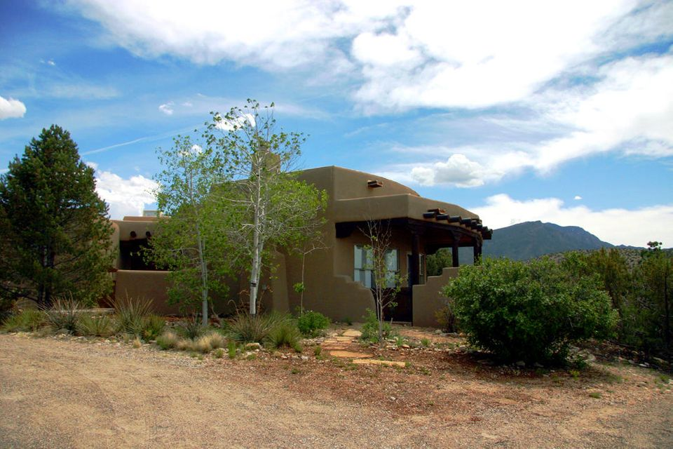 TWO MASTER SUITES!This Santa FE STYLE has Expansive views including Cabezon Peak miles away!Built with an extended family in mind, this floorplan lives ''BIG''. Great Room, Kitchen, Dining connected for great entertaining.Guest Suite.Quality is here.Beautiful courtyard views from every window. Reasonable covenants paved access,too. Placitas is known for great hiking, biking, exploring. Located near BLM, National Forests,scenic drives and much more.East Placitas living is quiet and peaceful. Sunrises,Sunsets and Night Skies are Amazing. Community of Placitas offers plenty to do, great library, shopping center, award winning restaurants.
