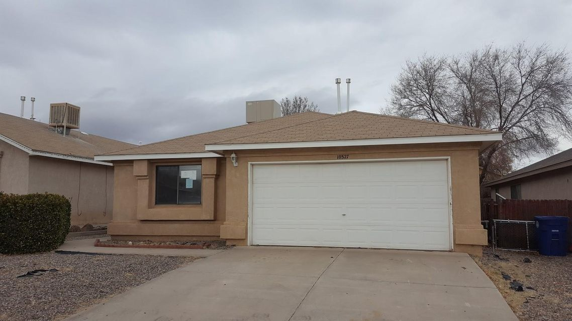 Great price on a 3 BR 2 BA home with a 2 car garage. Huge LR featuring tall ceilings, wood laminate flooring and fireplace.