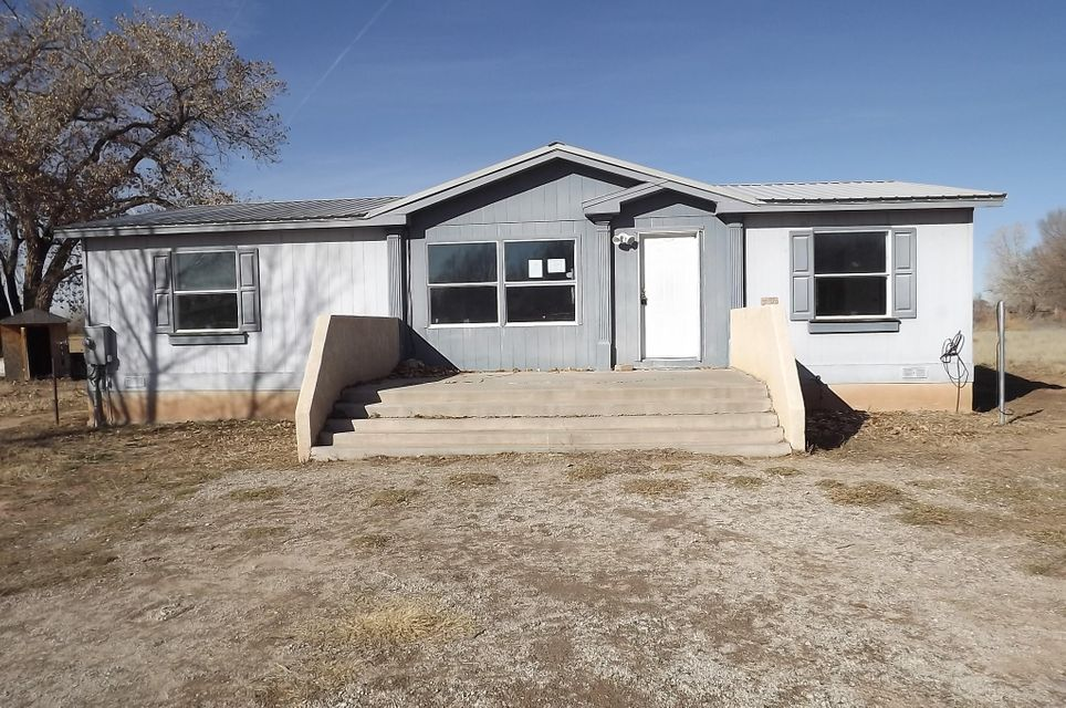 Well maintained Manufactured home on permanant foundation. 1.30 acres, 3 big Bedrooms and 2 full baths. Horses welcome.
