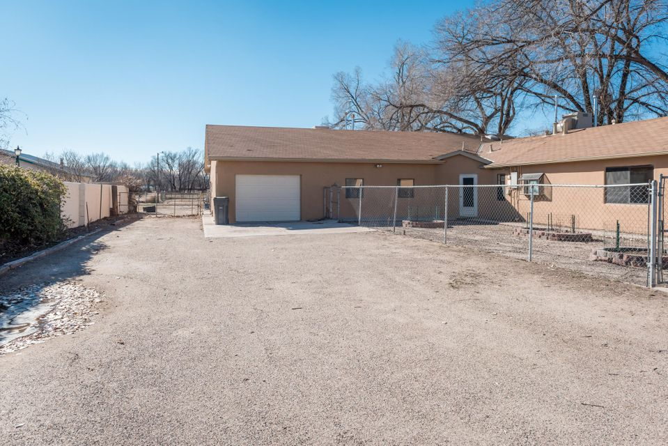 Horse property with irrigated, upgraded kitchen with granite counter tops, large patio, tack room, covered storage, green house, 6 horse stalls with paddock area, pig pen and chicken coop. Includes an additional .94 acre lot making the total acreage 2.2 acres.