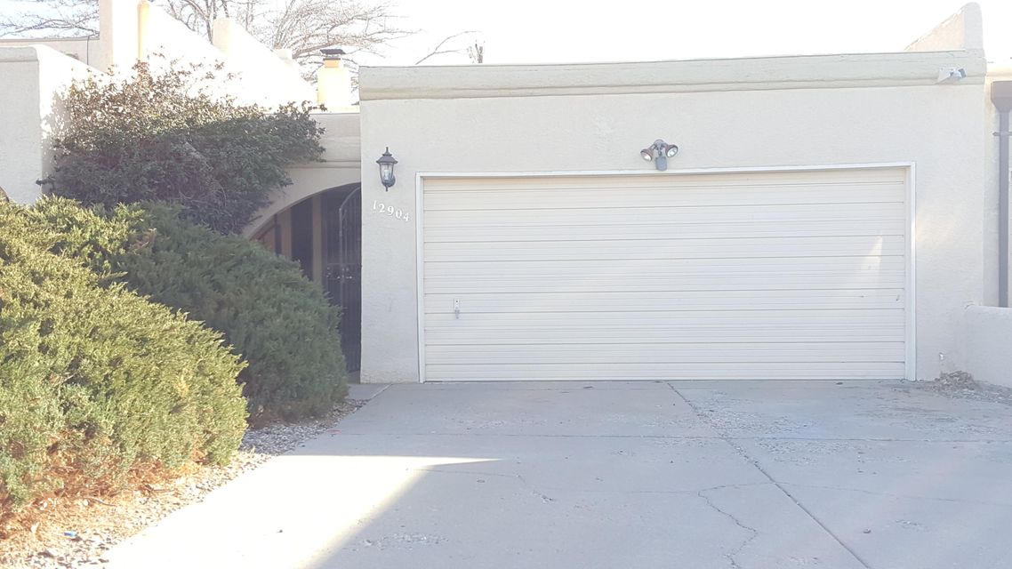 What a great Single story Townhome, 2bed/2bath northeast with easy access. 2 car garage. Wide open floor plan with plenty of skylites to let in all the wonderful southwest sun. New Paint, New Kitchen, Recent Refrigerated Air and Clean Ready to go. Backyard is large with covered patio and storage shed and alley access additional use.