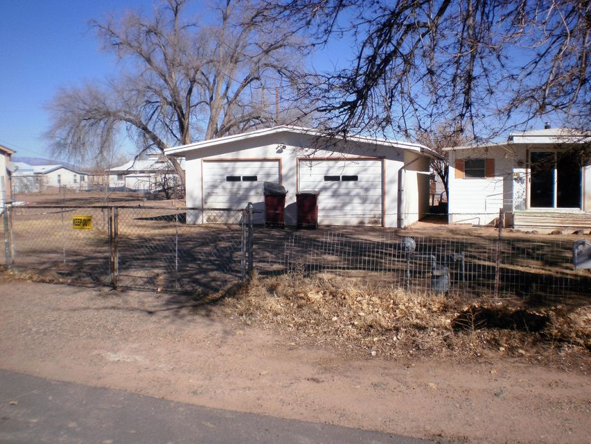 Nice size lot with nice double car detached garage. City utilities. Fenced .5 acre. Mobile home is very old, will not qualify for financing. Buyer can remove the mobile home. Listing broker is not responsible for actual square footage, size of rooms etc...