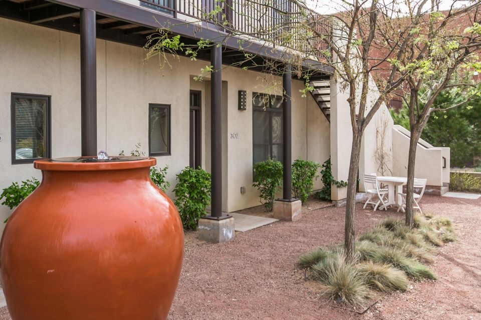 * Incredible Location! Quaint and intimate condo in the heart of downtown Albuquerque. Offering raised ceilings throughout, wood flooring, stainless steel appliances in kitchen, large master bedroom, bathroom and walk in closet. Enter through your private gate into one of two courtyard areas to find beautifully landscaped grounds and a private parking space. Walking distance to all of the amenities that downtown has to offer such as, shopping, restaurants, concerts, Zoo, aquarium, botanical gardens, Rio Grande river trails, Museums and convenient freeway access. Incredible location for a quiet evening. Come see and enjoy today!