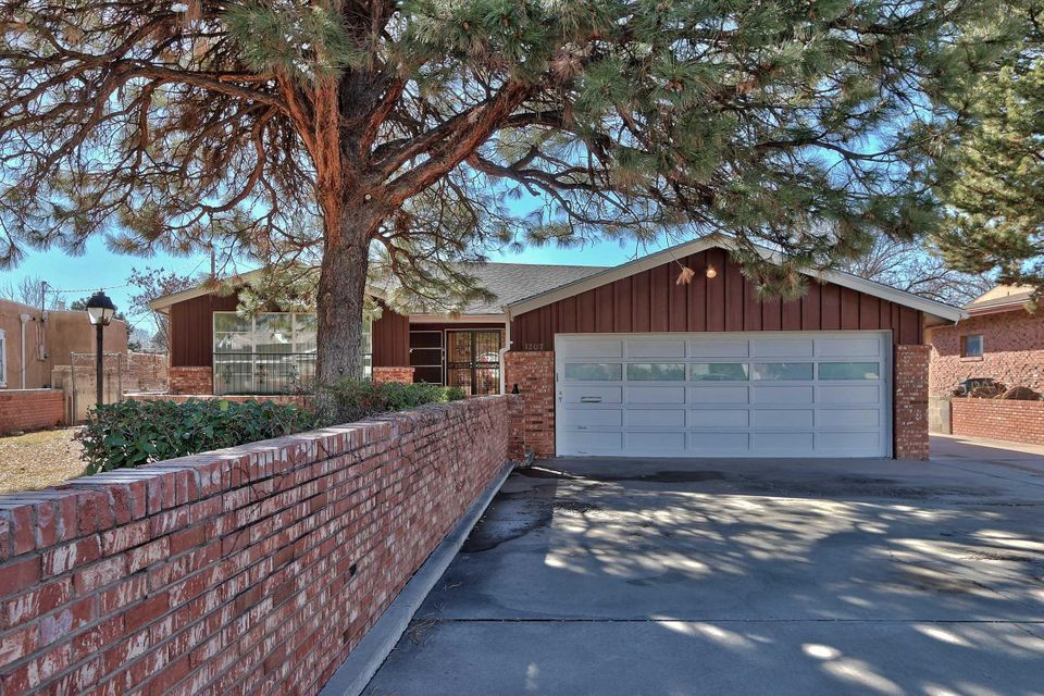 Located in the highly sought after Altura Park neighborhood under tall pine trees. Important to go inside to see that the home is far larger than it appears from the street because it is so deep. This wonderful ranch style home has a mid-century vibe, oversized rooms, wood floors,remodeled kitchen, tons of storage,  a sunroom , a large laundry room, a fantastic basement with a bedroom and a separate entrance.  The oversized garage has an entrance to the house and the basement. There is extra parking for cars other vehicles on the north side of the house.