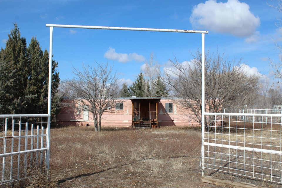 Budget problem solver- This single wide mobile home situated on .60 acres of valley land can be yours. Stop dreaming of home ownership and call now for your appointment to see this property. Full fenced down a quite county lane.