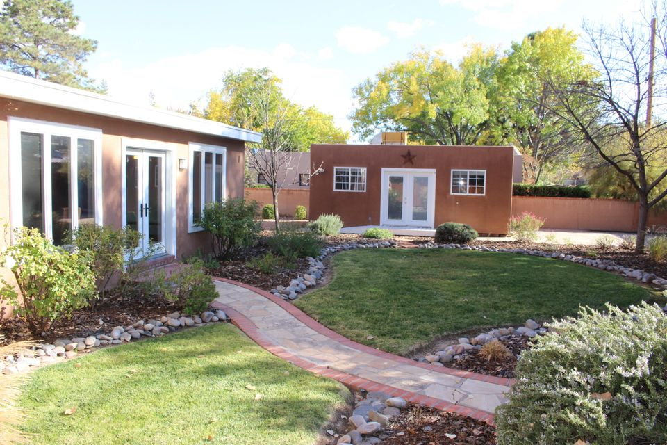 Welcome to this gorgeous & lovingly maintained, single-level home in the desirable ABQ Country Club Area!  Steps from Tingley Beach,dog park, bike trails, museums, restaurants & Old Town! This NM Territorial home has a remodeled kitchen w granite counters, breakfast nook & highend SS appliances.  The master has 2 walk-in closets, a fireplace & a beautiful bathroom w a garden tub & separate shower.  This home features two living areas, one w a formal dining room.  The park-like backyard has a gazebo and a casita with heating & cooling!  Nothing to do but move in!  Lots of extra details like beam ceilings, gleaming hardwood floors, brick floors, a butlers pantry, plaster walls, & high-end windows make this home very special. Must see to appreciate!  Come take a look and fall in love!